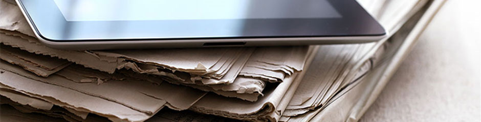 Newspapers and tablet